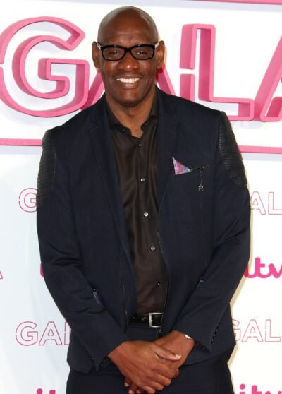 The Chase star Shaun Wallace smiles for cameras