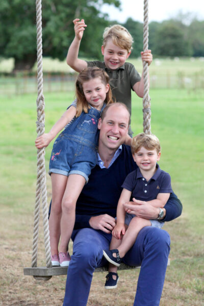 Princess Charlotte with her brothers and mum and dad