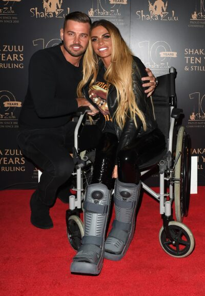 Carl Woods and Katie Price pose on the red carpet