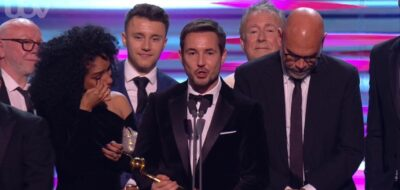 Martin Compston and wife on stage at NTAs
