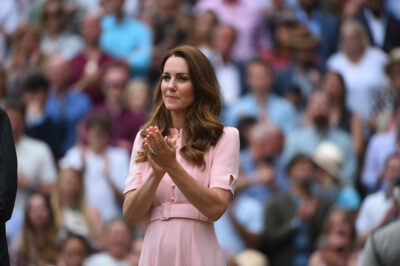 Kate in a pink dress at an outdoor event