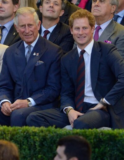 Prince Charles and Prince Harry smile at cameras