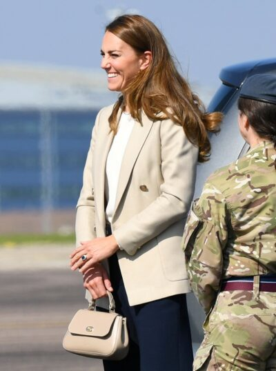Duchess of CAmbridge smiles during royal engagement today