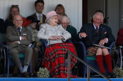 Prince Charles laughs with Prince Philip and the Queen