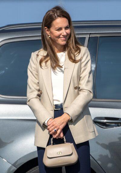 Kate Middleton smiles while visiting RAF Prize Norton