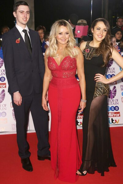 Carol Vorderman poses with her son and daughter