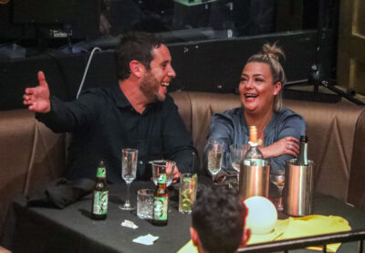 Lisa Armstrong and James green laugh during date night at Proud Cabaret