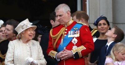 The Queen smiles while with Prince Andrew