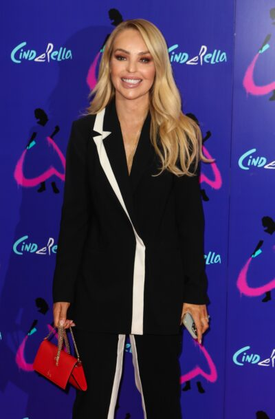 KAtie PIper smiles on the red carpet