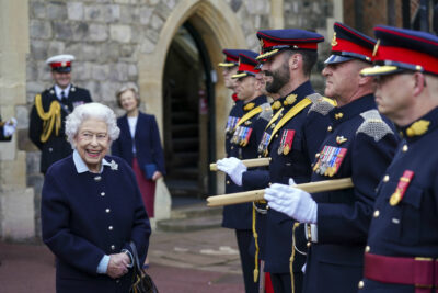 The Queen smiles while meeting soldiers