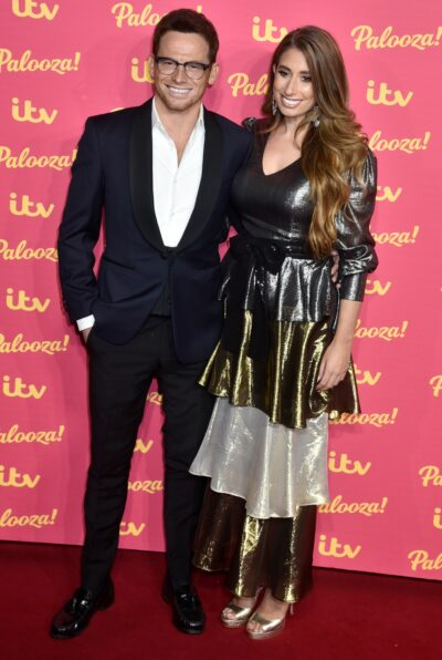 Joe Swash and Stacey Solomon smile on the red carpet