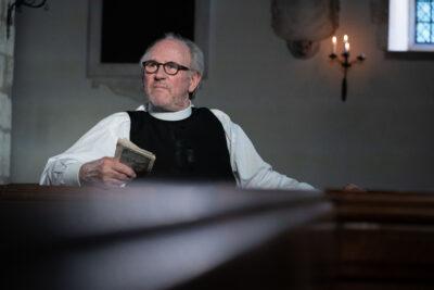 Peter Davison as the Vicar
