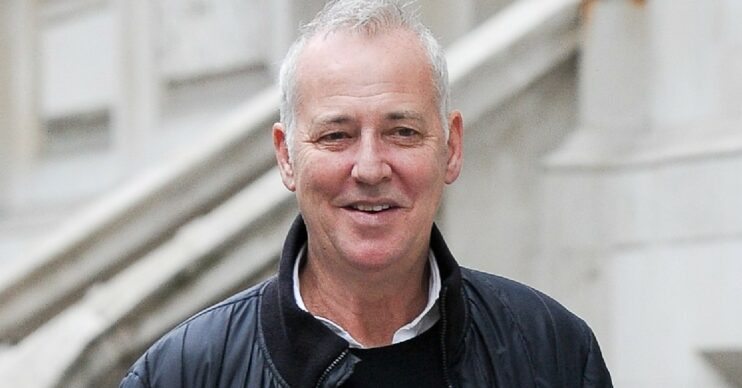 Michael Barrymore smiles as he's seen out and about