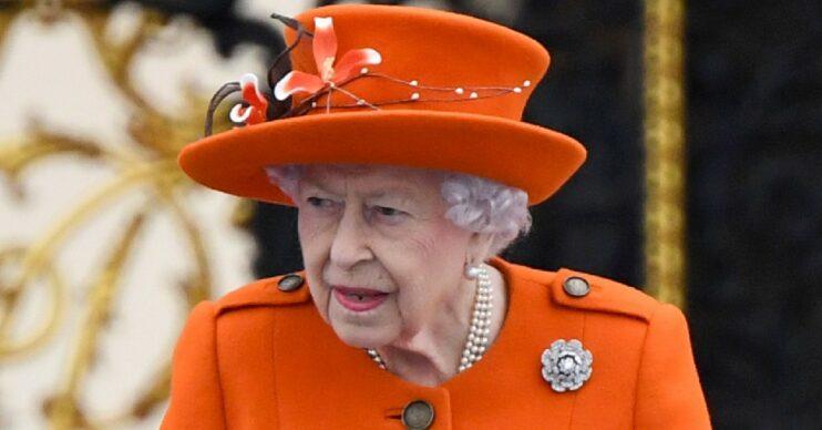 The Queen stuns in orange coat and hat